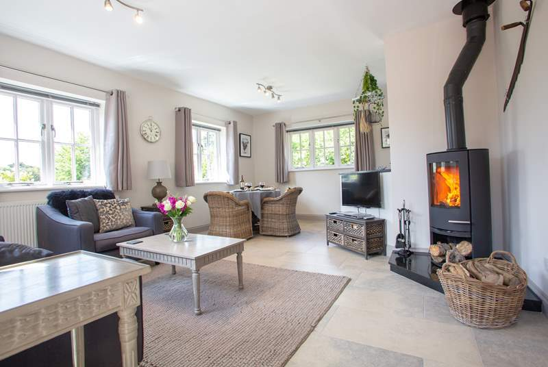 The luxury open plan living area complete with a cosy wood-burning stove.