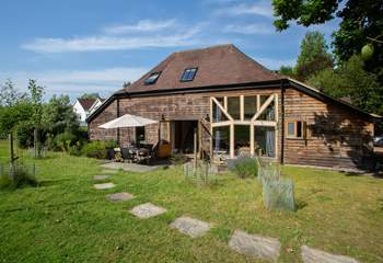 A stylish converted barn in a peaceful location.