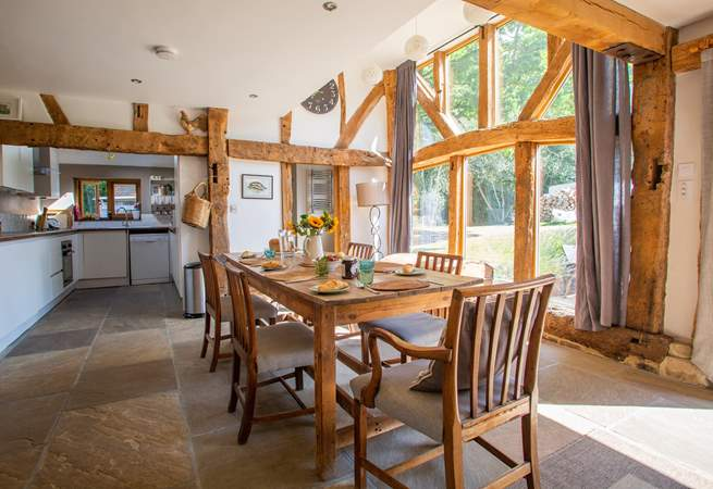 The floor to ceiling windows allow natural light to flood in.