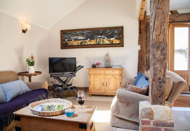 The spacious living area with stripped oak floors and ancient beams.