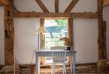 Writing desk with views to the garden and tennis court.