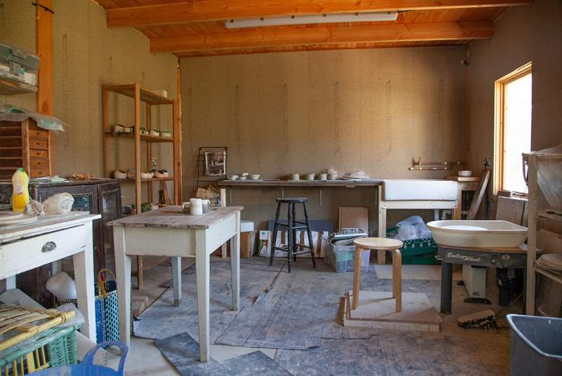 Book a pottery lesson in advance with the owner.
