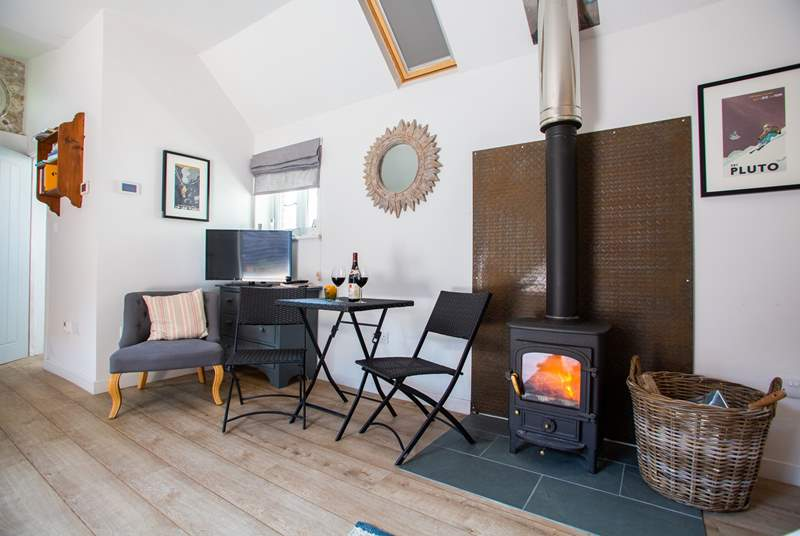 Relax by the cosy wood-burner.