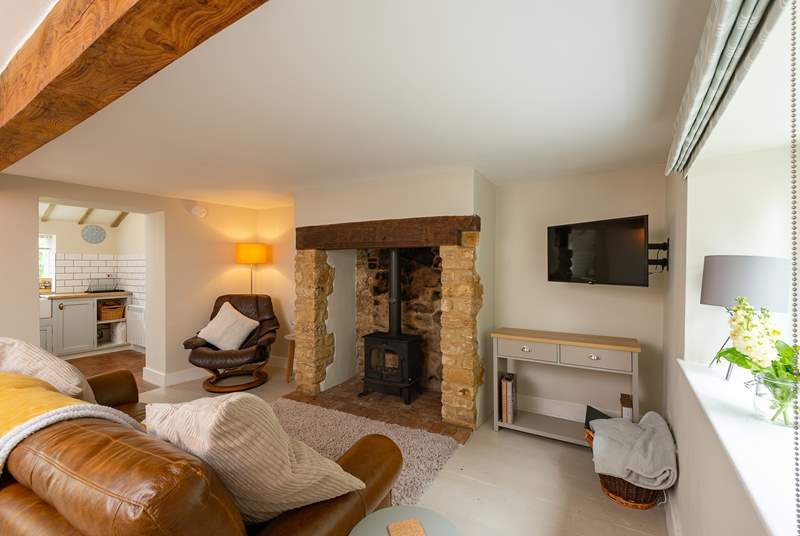 What a special fireplace! Light the fire and sink back in to the comfortable sofa.