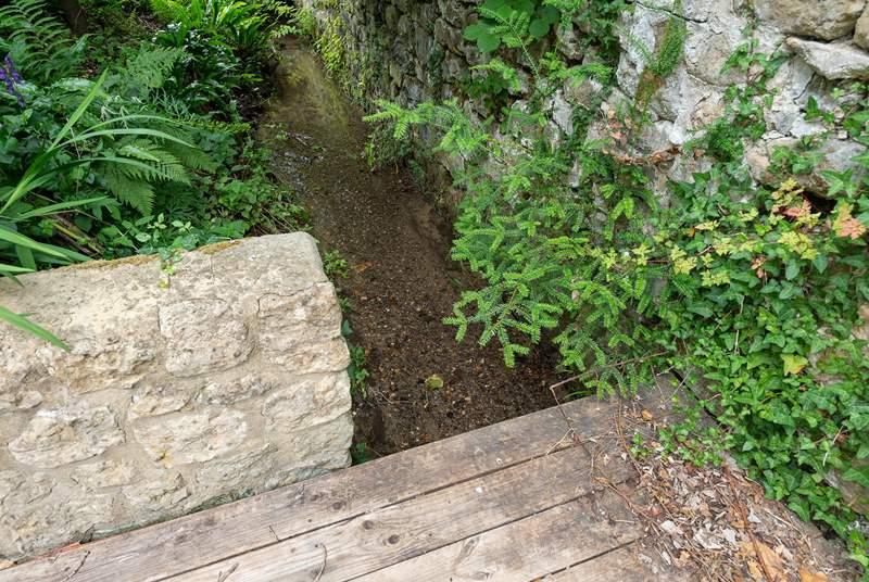 This is the shallow stream running along the far end of the garden, please take care. You can close the little gate in front of the summer-house if you wish to keep this area inaccessible.