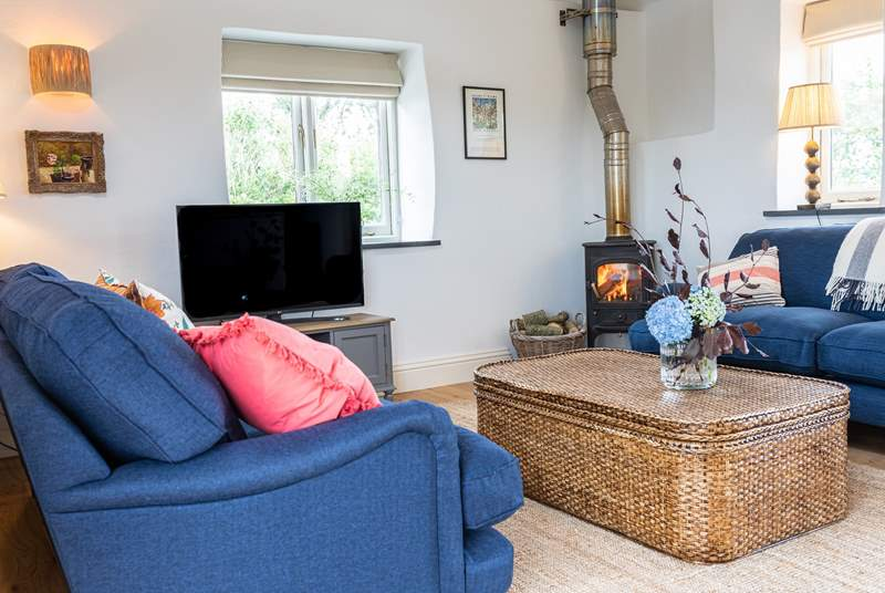 The living-area has a cosy wood-burner and sea views over to Nare Head.