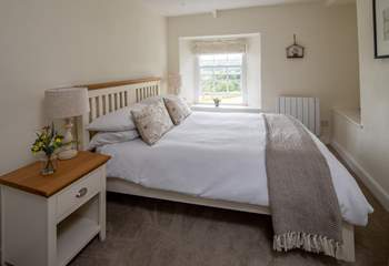 Bedroom 2 is light and airy, also with fabulous views out over the rolling countryside.