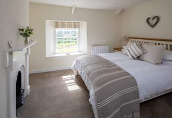 Bedroom 1 is super pretty with fabulous countryside views.