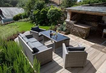 Such a beautiful garden and decked area, with a fabulous undercover area to store barbecue food or take shelter if required.