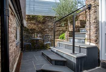 If you don't fancy taking the steps to the top patio, this cute bistro table for two is right on your doorstep.