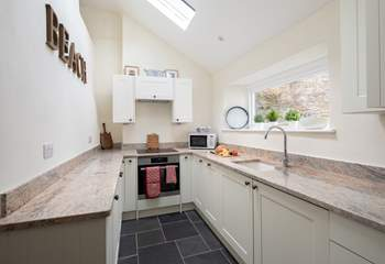 The kitchen is light, airy and fully equipped with everything you will need to whip up a family feast.