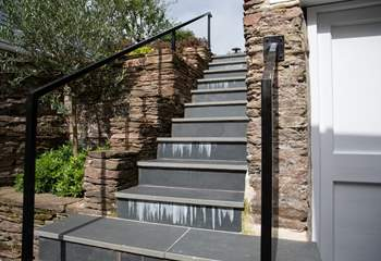 From the kitchen door, there are 21 steps up to the top patio.