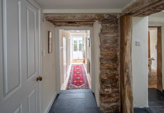 The hallway which runs through the ground floor. Please watch the small steps which lead in and out of the ground floor rooms.