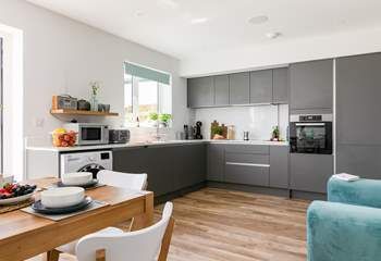 The open plan kitchen area is the perfect place to enjoy long chilled evenings.