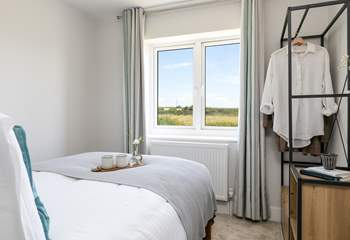 Bedroom 3 overlooks the fields, and you may even spot the local donkey grazing away.