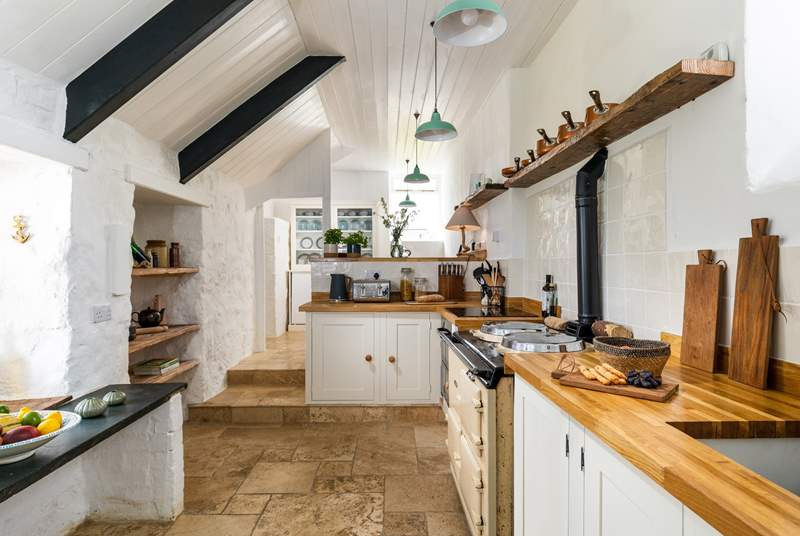 The fabulous kitchen awaits you, please take care with the sloping ceilings and low door in the kitchen.