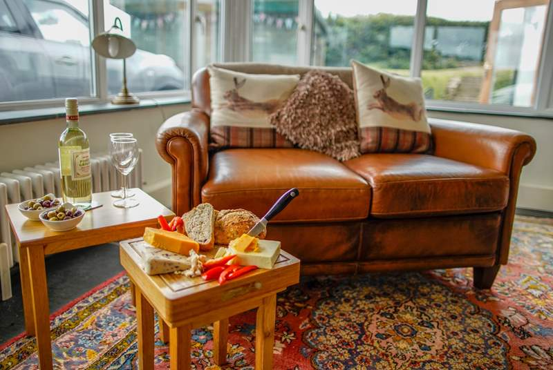 The sitting-room benefits from an extension allowing you to sit and enjoy the views or sit back and enjoy a film. Please note there is one step down from the original foot print of the cottage in to this extension area.