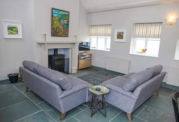 The living area benefits from a Smart TV and wood-burner with the original slate floor.
