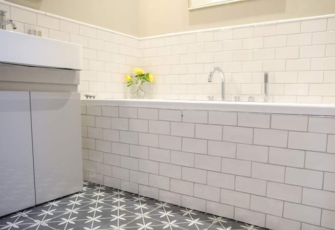 The main bathroom sits off the hall offering a bath, WC a wash-basin and under-floor heating.