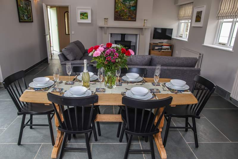 The dining-table sits centrally to the room and opposite the patio doors out on to the garden.