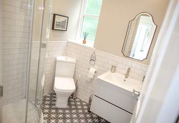 The shower-room benefits from under-floor heating and is situated next to bedroom 3.