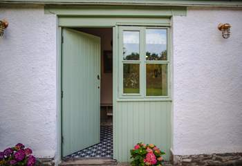 The front door into the cottage opens up into the hallway.