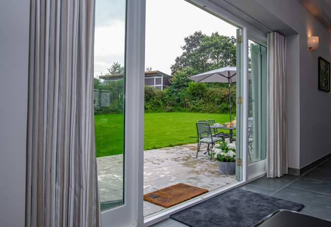 The patio doors open on to the enclosed garden and patio area with the paddock and stables being fenced off to the top of the main garden area. This is part of the cottage and will be for your exclusive use.