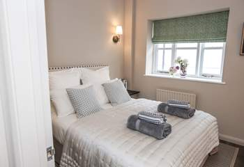 Bedroom 3 offers a tranquil room furnished beautifully.