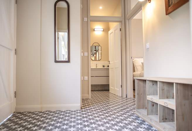 The hall benefits from under-floor heating with plenty of storage for shoes and coats. From here you can access bedroom 3 and the shower-room.