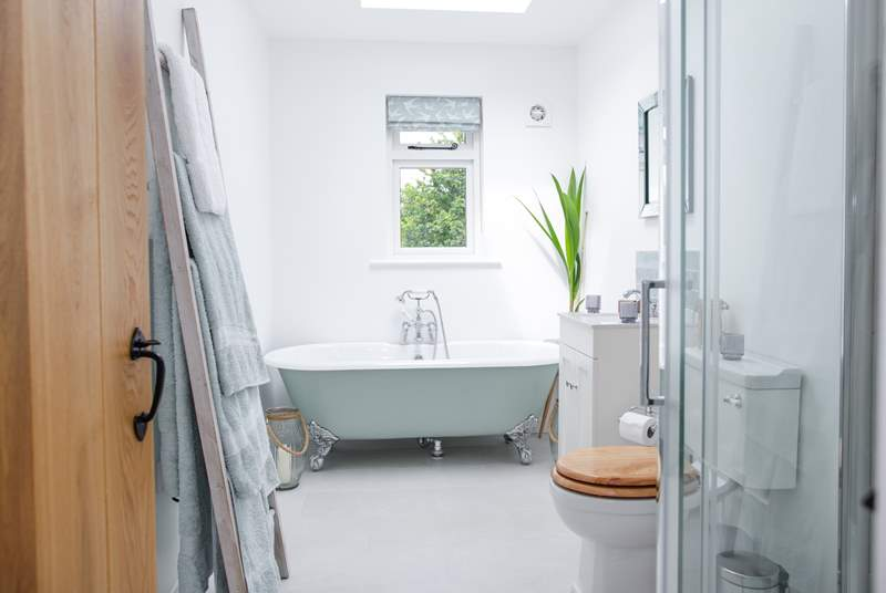 A bathroom with a view offering the perfect chill out zone with the benefit of under-floor heating.