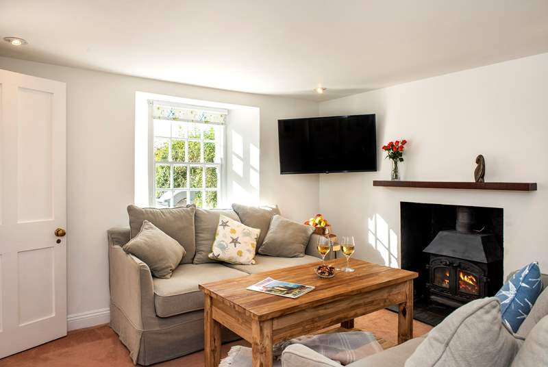 The cosy sitting-room with its toasty wood-burner makes this a perfect retreat all year round.