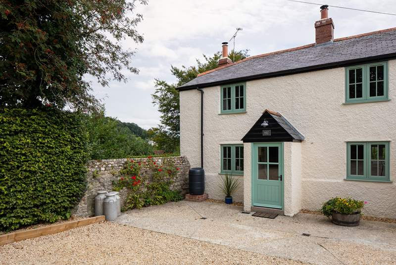 Poacher's Cottage is on the far left of a row of four terraced cottages.
