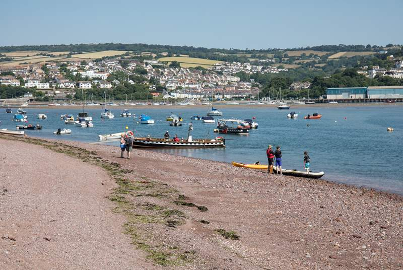 Shaldon beach, bustling with water activity.