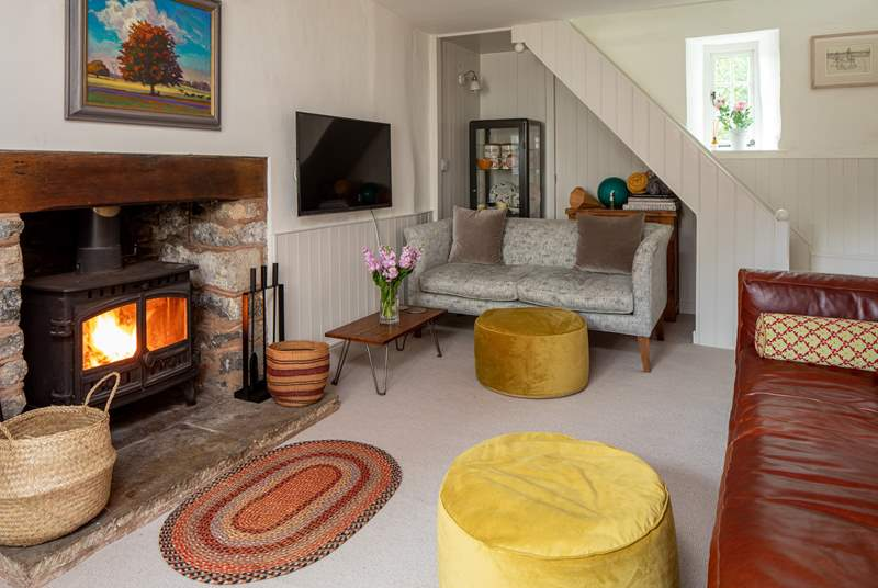 Light the fire and relax in the beautiful sitting-room. Please be aware that the stairs are open-sided so do take care.