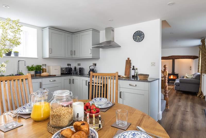 The cottage has an open plan feel between the sitting-room and the kitchen/diner.