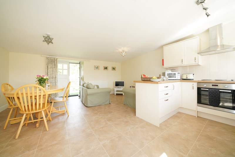 The spacious open plan living-room with kitchen and dining areas.