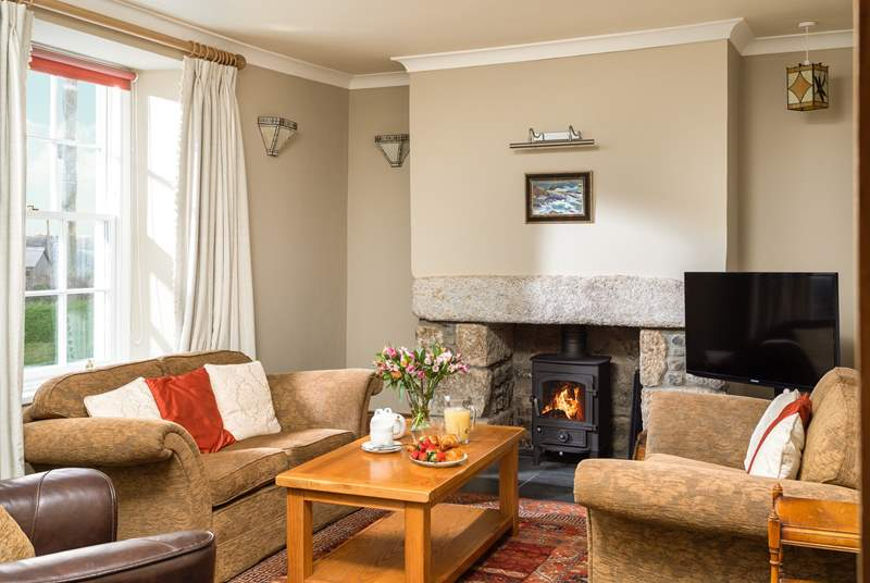Snuggle down in front of the fire, the front sitting room is lovely and cosy.