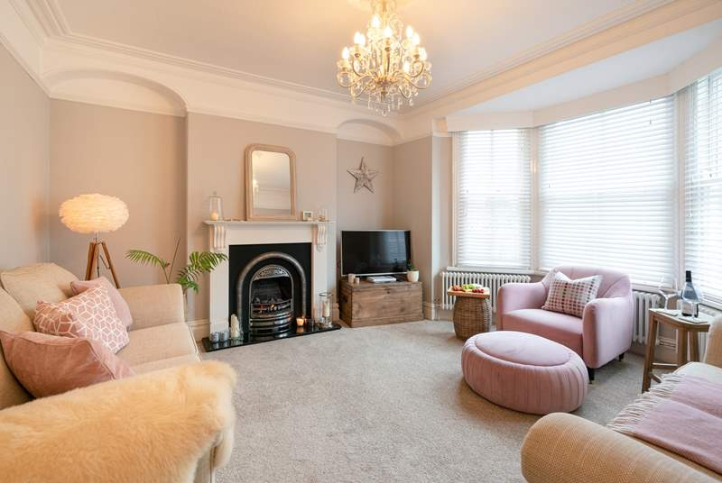 Stylish sitting-room with touches of pink.