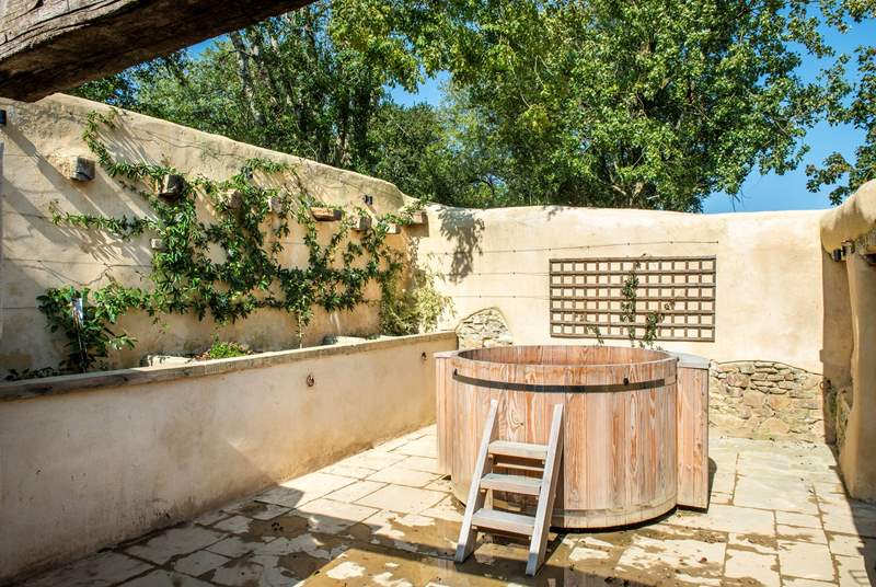 The setting for the hot tub has an almost Mediterranean feel - not bad for an old derelict barn!