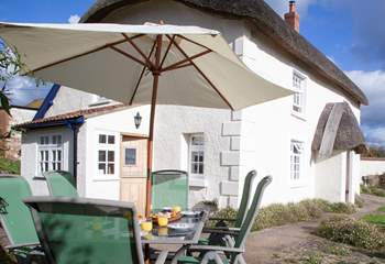 Enjoy the sun terrace; the perfect place for al fresco living with wonderful views from the enclosed garden.
