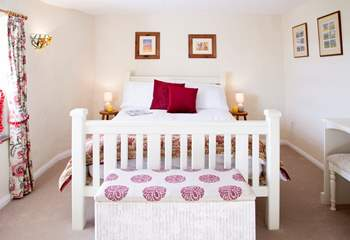The main bedroom is at the front of the house and has delightful views of the countryside.