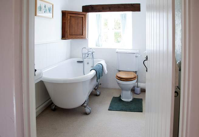 The main bathroom is upstairs and has the luxury of a roll-top bath.