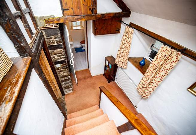 This Grade II Listed cottage retains so many original features and many rooms are accessed via steps up and down.