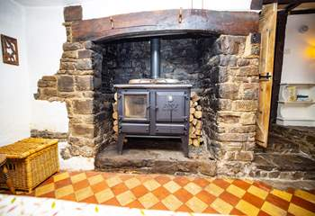 This old fireplace was where all the cooking was done, long before the days of gas or electricity! (This is no longer in use). The floor is also original, just one of the many features throughout this characterful house.