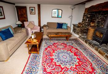 The sitting-room benefits from being a generous size with enough seating for all the family and everyone will enjoy the glow of the log-burner.