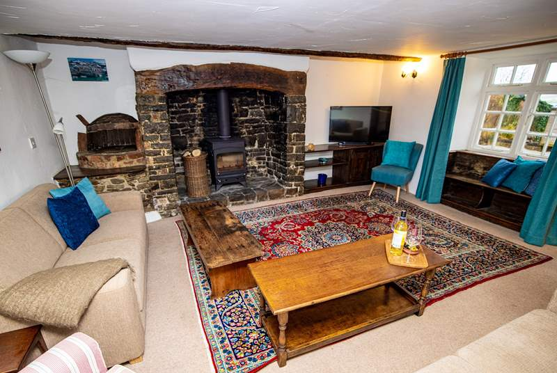 The sitting-room benefits from this wonderful wood-burner for those autumnal nights and not forgetting those wonderful views from the window seat.