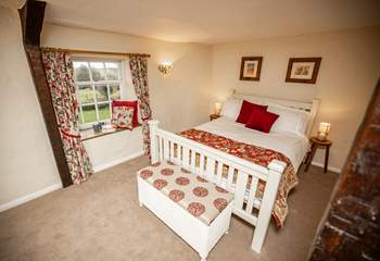 The main bedroom is at the front of the house and has delightful views of the countryside, best enjoyed from taking a seat in the window.