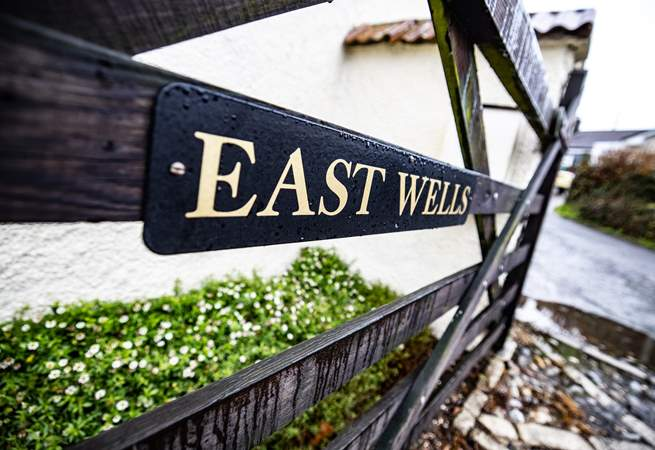 East Wells is accessed through a gate, drive through and it will take you to the back of the house.