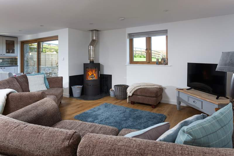 Snuggle up in front of the cosy wood-burner.