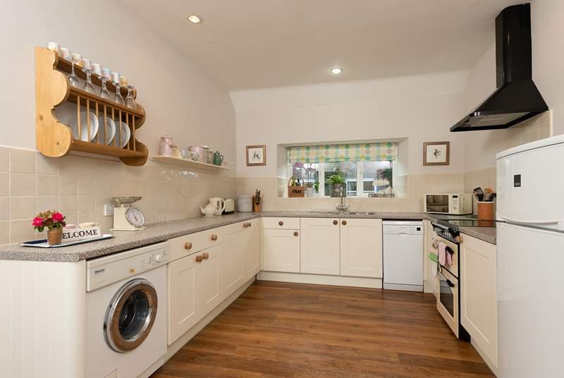 A lovely country-style kitchen is equipped to the highest standard.